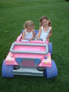 My daughter and niece on her Jeep